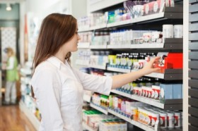 woman-in-pharmacy-selecting-medications